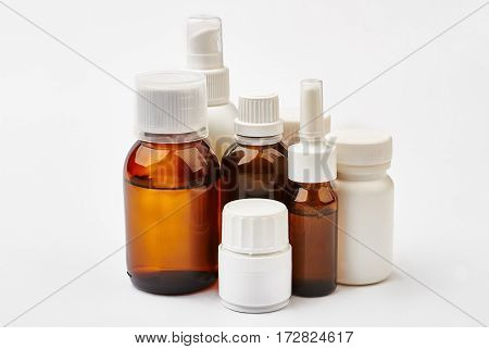 Pill containers and brown bottles. Glass and plastic medical vials. Fight germs and viruses.