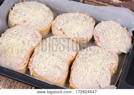 Sandwiches With Ham And Grated Cheese