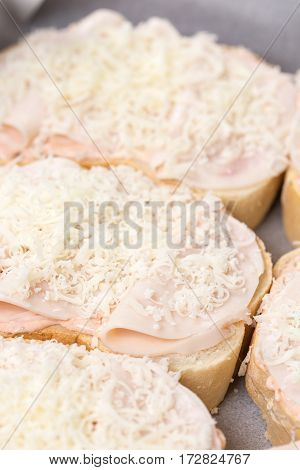 Closeup Macro Sandwich With Ham And Grated Cheese