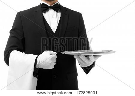 Handsome waiter with metal tray on white background, closeup