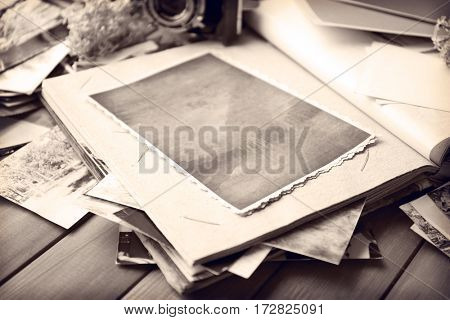 Vintage composition with old photos on wooden table