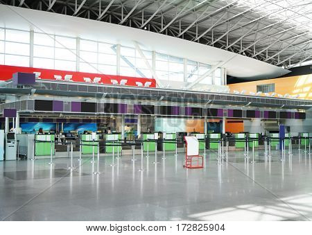 Airport building inside, check-in cabins