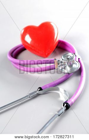 Red heart, stethoscope and medical equipmenton on white background.