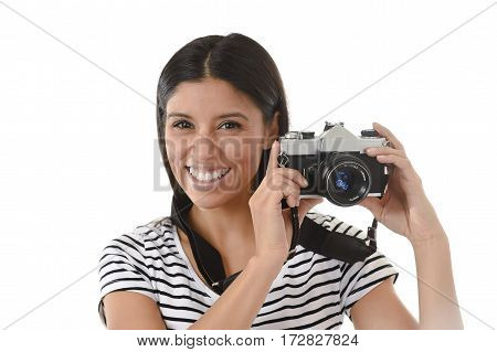 young attractive latin woman taking pictures posing smiling happy using cool retro and vintage photographic camera smiling happy in photography hobby having fun learning pro photo shooting