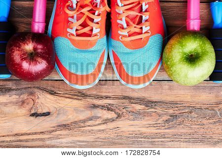 Sneakers, apples and jump rope. Advertisement of new sport center.