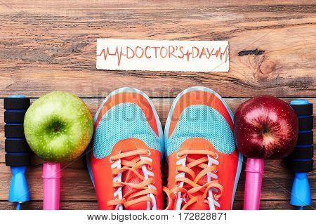 Apples, sport shoes and card. Medical national holiday.