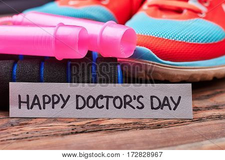 Jump rope, shoes and card. Congratulation for doctors.