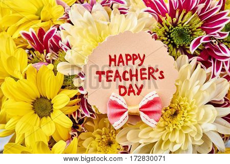 Flowers and Teacher's Day Card. Congratulation with Knowledge Day.