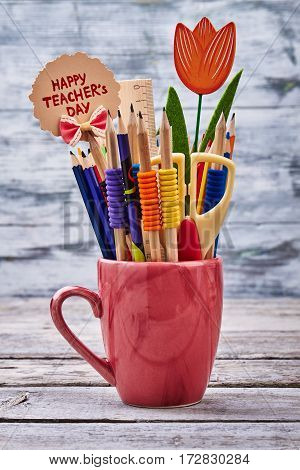 Crayons, card, cup and scissors. Let's celebrate teacher's Day.