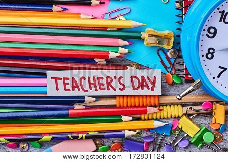 Set of crayons and card. Celebrate Teacher's Day memorably.