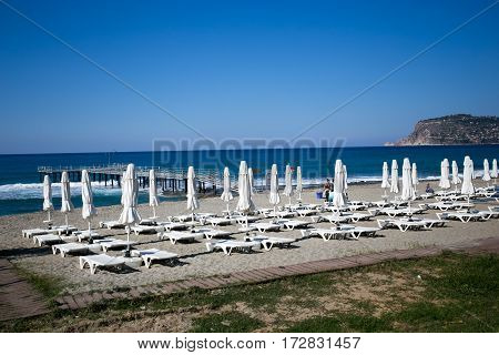 Beautiful Beach With White Sunbeds And Umbrellas