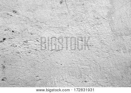 Old white painted wall background texture closeup