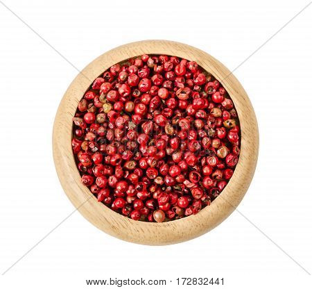 Pepper red peppercorns in wooden dish isolated on white background. Save clipping path.