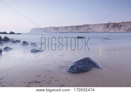 Serene seascape in Arrigunaga beach Biscay Basque Country Spain. Long exposure on a misty sunset.