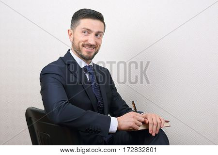 portrait of successful smiling business man in suit
