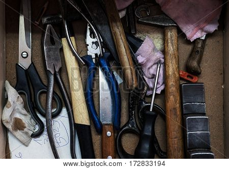 Closeup view of craftsman's drawers various tools details.