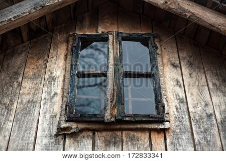 Wooden window of an old house exterior view.