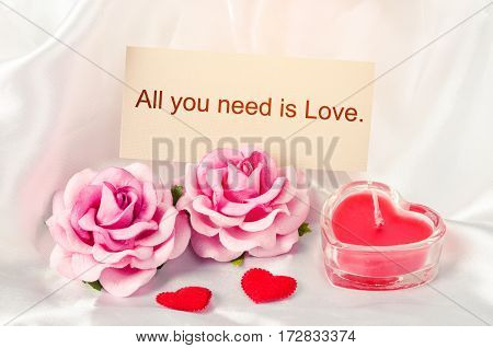 All you need is love card on decoration.