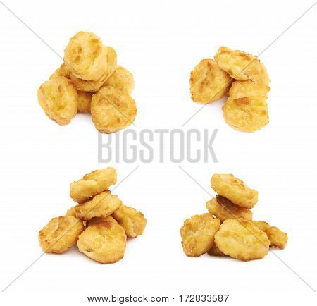 Pile of multiple breaded chicken nuggets isolated over the white background, set of four different foreshortenings