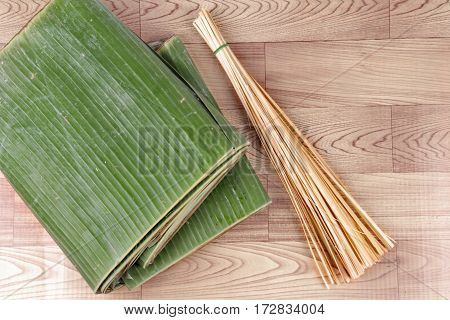 Thai Wrap Dessert Cooking As Banana Leaf And Thin Bamboo.