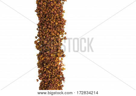 Szechuan Peppercorns in Vertical Row on Isolated White