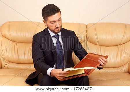 young businessman looks at the working papers