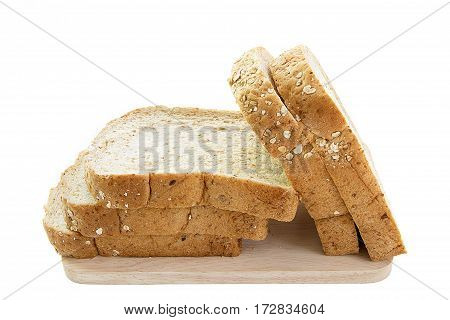 whole grain bread and slices on wooden cutting board and on white background