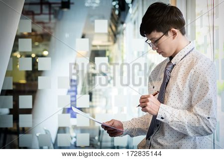 Young Businessman Reviewing Documents Conference Working Planning Thinking Ideas Strategy Seriously