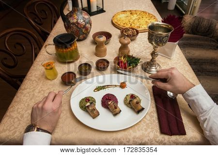 Man eating in georgian restaurant with national dishes, pov view