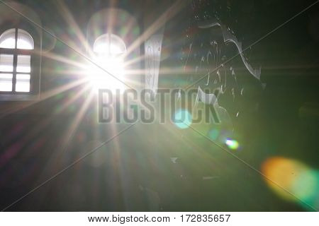 Inside Christian Church - sunlight through window at sunny day, horizontal