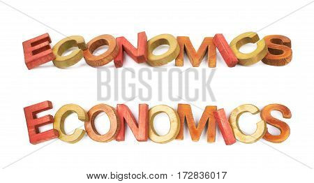 Word Economics made of colored with paint wooden letters, composition isolated over the white background, set of two different foreshortenings