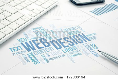 Web Design business concept word cloud print document keyboard pen and smartphone keyboard pen and smartphone. Blue toned.