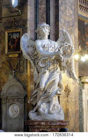 ROME, ITALY - SEPTEMBER 03: Statue of the Angel with the scroll by Bernini in Basilica di Sant Andrea delle Fratte, Rome, Italy on September 03, 2016.