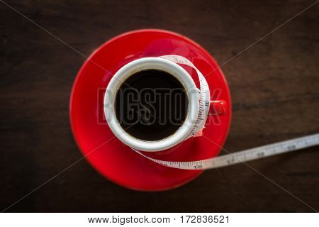 Red cup of coffee on wooden table stock photo