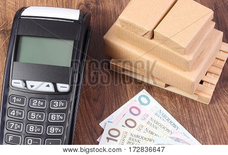 Payment Terminal, Polish Currency Money And Wrapped Boxes On Wooden Pallet