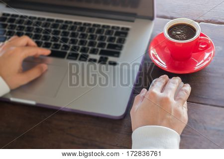 Woman's hand typing keyboard of laptop stock photo