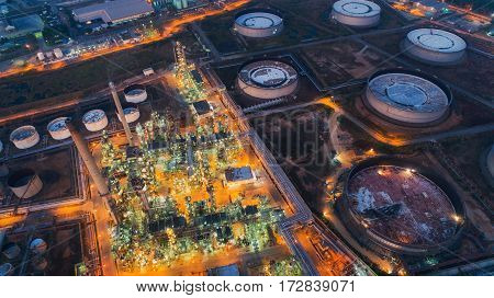 Land scape of Oil refinery plant from bird eye view on night refinary plant with oil tank storage Petrochemical plant chamical plant Chonburi Thailand