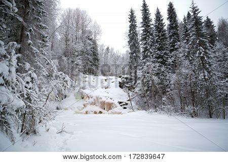 Frozen waterfall Yukankoski overcast, January day. Winter Karelia