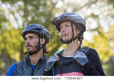 Biker couple standing together in countryside
