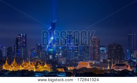 BANGKOK -THAILAND 29 AUGUST 2016 : Mahanakhon bangkok rising lightshow MahaNakhon is now officially the Tallest At 314 meters Building in bangkok thailand. cityscape in night of Bangkok Thailand with wat phra kaew and Pho temple.