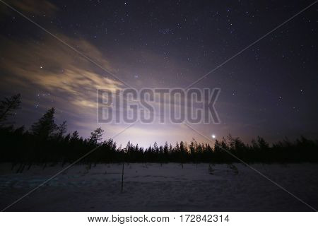 Bright starry night landscape in Finnish Lapland