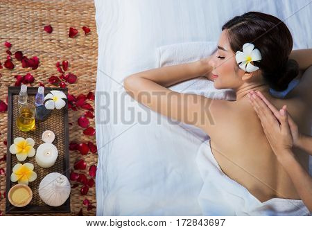 The girl relaxes in the spa salon with hand massage
