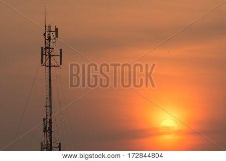The radio towers dominate the skyline has cut the orange morning sun shining beautifully plastered horizon.