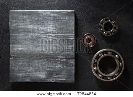 bearings tool on black background texture
