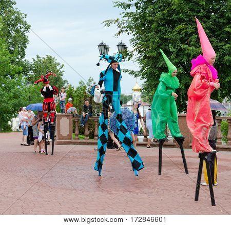 VITEBSK BELARUS - JULY 13 2016: Buffoons on stilts during festival Slavic Bazaar Vitebsk Belarus
