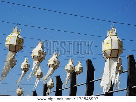 white and gold local hand craft lanterns with blue sky background
