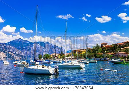 Scenic lake Lago di Garda, view with sailing boats, Northen Italy