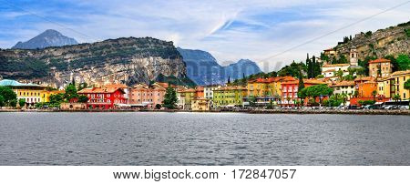 Alpine scenery - beautiful lake Lago di Garda and village Torbole, Italy