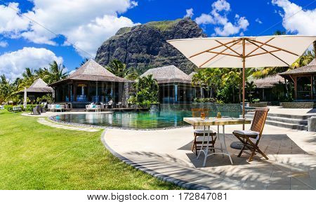 Relaxing  bar in palm shade in tropical paradise. Mauritius island