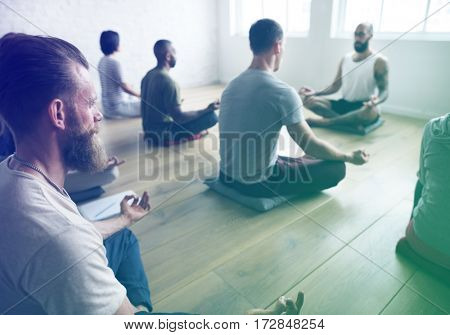 People concentrating to meditate while sitting